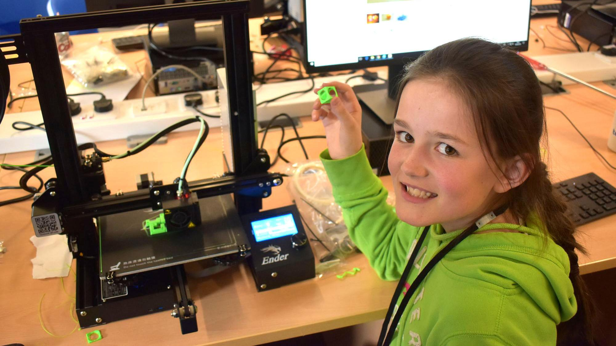 Girl using a 3D printer