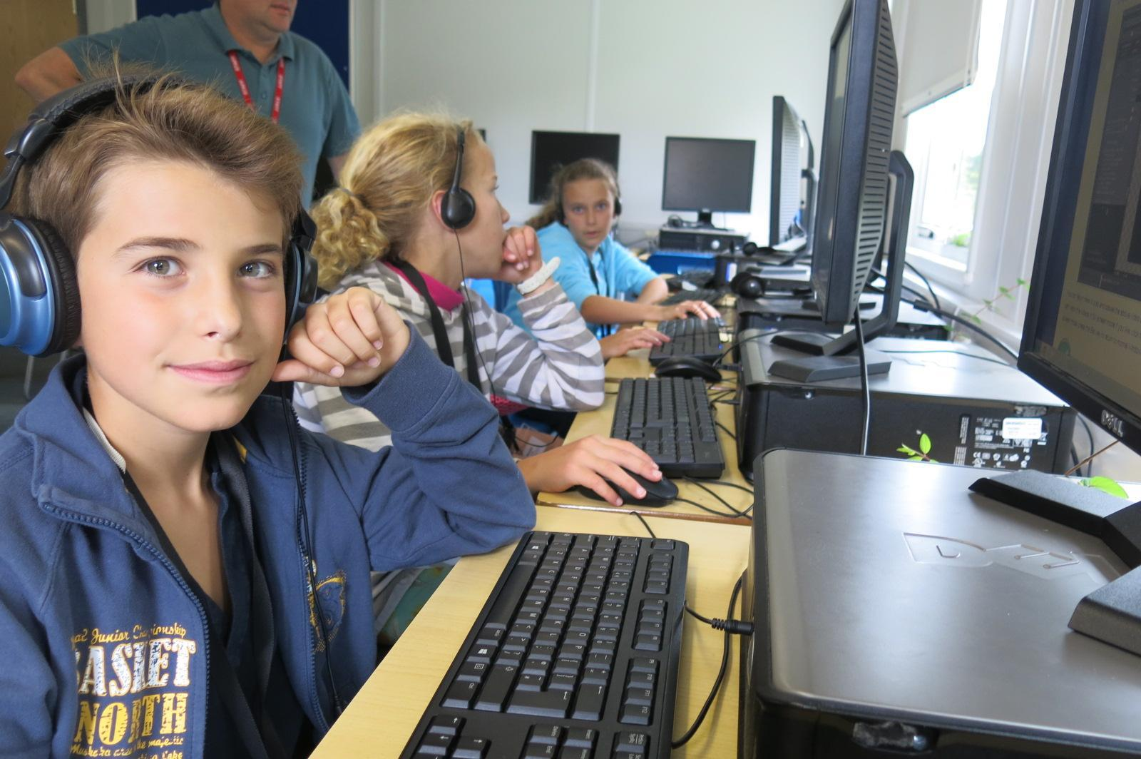 Happy children using computers