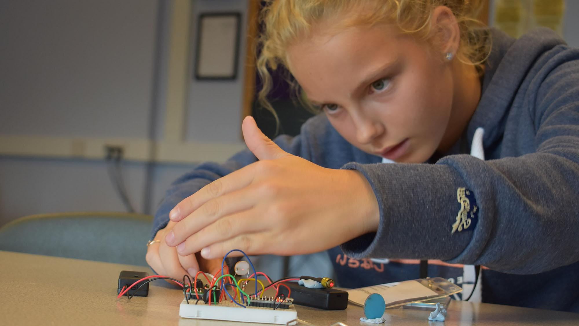 girl participating in engineering camp